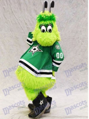 Victor E. Green de Dallas Stars Mascotte Costume Furry Green Alien avec des bâtons de hockey